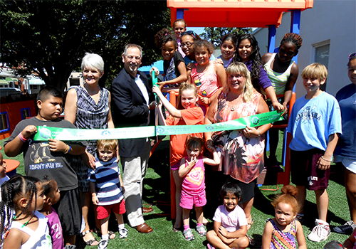 ribbon cutting for the new playground at West Chester Area Day Care, presided over by Director Betsy Billie, Mayor Comitta, and Mark Yoder