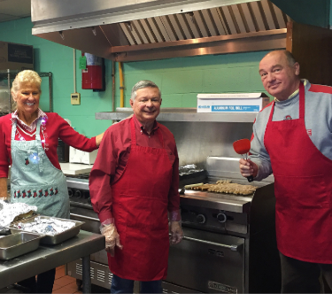Mary, Richard, and John (and Orlando not pictured) cooking as always for Santa and his friends!